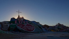 Timelapse of Sunrise over Famous Painted Landscape in Slab City -Pan Left- Stock Footage