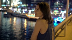 Young woman admire cityscape and river in city at night Stock Footage