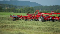 Big red machinery for raking hay Stock Footage