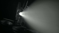 Light projector ray in dark room Stock Footage
