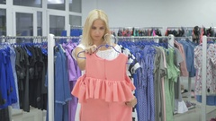 Three beautiful girls shopping in the showroom Stock Footage