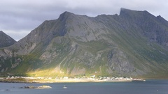 The village Fredvang at the foot of a big mountain range Stock Footage