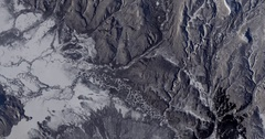 High-altitude overflight aerial of volcanic tundra, Kamchatka peninsula, Russia Stock Footage