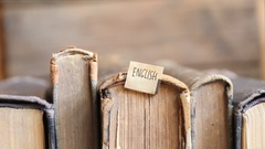 Learning english idea, Education concept, tag and vintage books Stock Footage