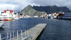 Pier at the harbour of village Henningsvaer Stock Footage