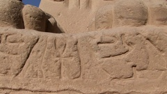 An egyptian statue in sphinxes avenue in Luxor temple tilt up Stock Footage