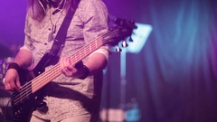 Man playing guitar at a rock concert. Bass Guitar closeup. Stock Footage