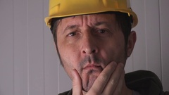 Confused construction worker with yellow hardhat Stock Footage