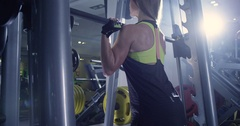 Young sexy women in the gym doing squat with barbell Arkistovideo