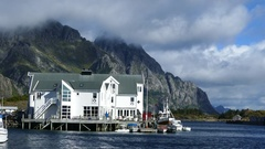 Big white house in a fishing village Stock Footage