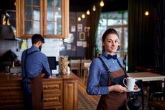 Waitress, a waiter working at cafe bar restaurant Kuvituskuvat