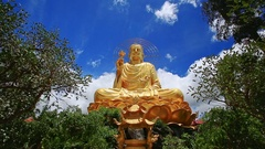 Closeup Large Gold Buddha Statue against Blue Sky in Vietnam Stock Footage