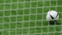 Soccer player kicks ball in the goal Stock Footage