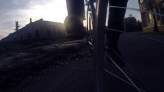Cycling around at sunset. Slow motion of low angle view of bicycle riding Arkistovideo