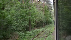 Tram moving in green forest Stock Footage
