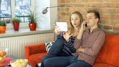 Woman disturbs her boyfriend while he is talking on cellphone, steadycam shot Stock Footage
