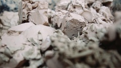 Clay divided into pieces, ready for sculpting. Sculptor chooses what to get Stock Footage