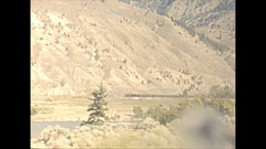 Vintage 16mm film, 1946 BC, drive plate into Thompson valley passenger train Stock Footage
