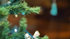 Female hands hanging balls on the Christmas tree. Winter holidays Christmas and Stock Footage