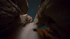 MoCo Astro Timelapse of Stars thru Sandstone Arch Formation in Desert -Zoom In- Stock Footage