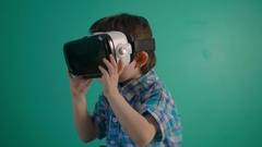 Little boy use virtual reality headset helmet. VR. Virtual reality. 4K Stock Footage