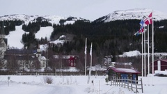 Cottage in ski resort in Sweden. Trail with people riding skis and snowboard Stock Footage