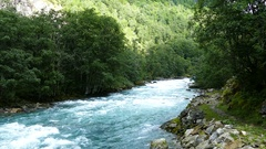 Clear blue water river in Morkidsdalen park Stock Footage