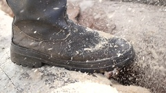 Closeup of the feet of a man operating a chainsaw Stock Footage