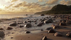 Beautiful sea coast with rocks and cliffs on a background of beautiful clouds in Stock Footage