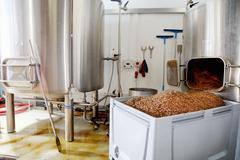 Spent grains from mash tun in large container Stock Photos