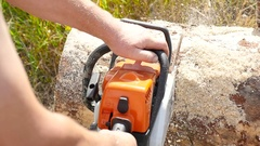Cutting through wood with chainsaw Stock Footage