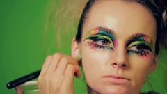 Face art beauty makeup. Visagiste makes makeup for model, professional makeup. Stock Footage