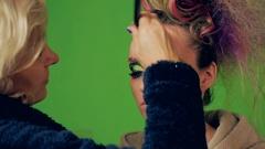 Face art beauty makeup. Visagiste makes makeup for model, Stock Footage