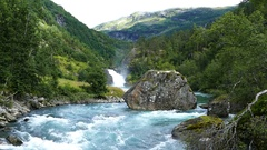 Big stone in a clear blue river at Morkidsdalen park Stock Footage