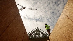 Construction worker, looking up at roof beams Stock Footage