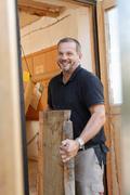 Man carrying timber Stock Photos