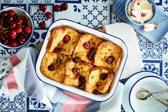 Cherry bread and butter pudding Stock Photos