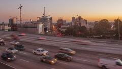 4K hyperlape of freeway traffic from day to night Stock Footage