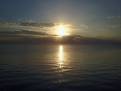 CALM SUNRISE AT SEA DRAMATIC APPROACH Stock Footage