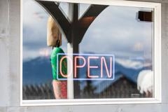 Neon open sign on window, Homer Spit, Kachemak Bay, Alaska, USA Stock Photos