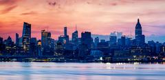 Skyline illuminated at sunset, Hoboken, New Jersey, USA Kuvituskuvat