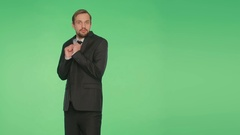 Man in a suit on a green background. body language. fright. hromakey Stock Footage