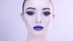 Portrait of beautiful woman with outstanding makeup Stock Footage