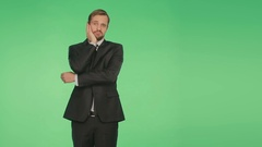 Body language. a man in a business suit on a green background. hromakey, Stock Footage