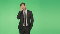 Businessman on a green background, gesture chagrin. body language. hromakey, Stock Footage