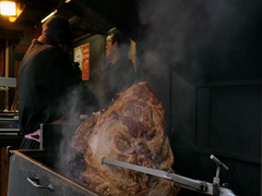 Typical Czech food Prague Ham at the Christmas Market in Prague Stock Footage