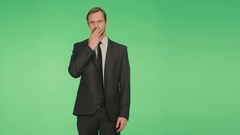 Gestures distrust lies. body language. man in suit isolated on green background. Stock Footage