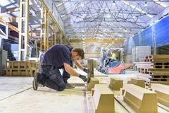 Worker moulding stone in architectural stone factory Stock Photos