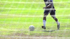 A man playing soccer on a grassy field, super slow motion. Stock Footage