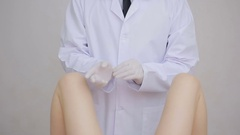 Doctor gynecologist performing an examination Stock Footage
